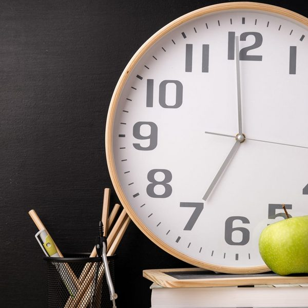 Composed stacked books with clock and fresh apple in arrangement with school stationery. ; Shutterstock ID 768035833; Purchase Order: TODAY.com; Segment/Job:  ; Client/Licensee:  ; Other: